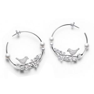 Boucles d'Oreilles Oiseaux Diamants et Perles Blanches de Piaget
