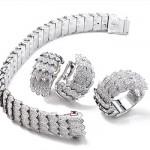 Parure Collection Cobra, Or blanc et diamants.