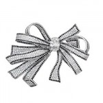 Broche Ruban - Lumière de Chanel Joaillerie.