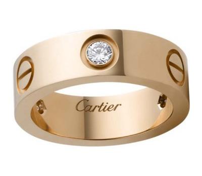 Bague Love de Cartier en or rose et diamant