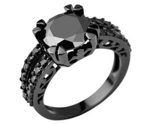 Bague de fiançailles en or noir et diamants noirs
